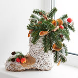Christmas arrangement of felt boot decorated with toys. Stock Image