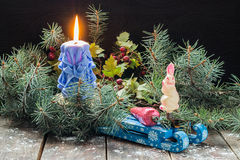 Christmas arrangement of fir branches, Christmas toys and burnin Stock Photos
