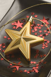 Christmas arrangement. Golden star. Royalty Free Stock Photos