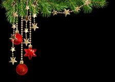 Christmas arrangement with green pine twigs and hanging red decorations royalty free stock photos