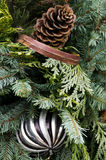 Christmas arrangement greens ribbon ornament cones Royalty Free Stock Photography