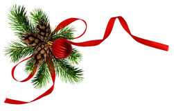 Christmas arrangement with pine twigs, cones and red silk ribbon. Bow isoaletd on white stock photography