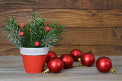 Christmas arrangement and red baubles Stock Photo