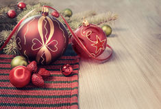 Christmas arrangement in red and green on wood Royalty Free Stock Image
