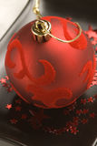 Christmas arrangement. Red velvet ball. Royalty Free Stock Photography