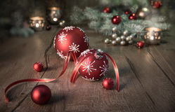 Christmas arrangement in red and white on wooden table Royalty Free Stock Photo
