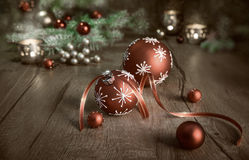 Christmas arrangement in red and white on wooden table Royalty Free Stock Photography