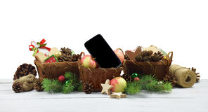 Christmas arrangement in a rustic style. Smartphone and festive Stock Images