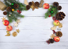 Christmas arrangement with toys made of wood and straw, apples. Royalty Free Stock Image