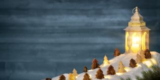 Christmas scene in warm candle light of a lantern royalty free stock photos