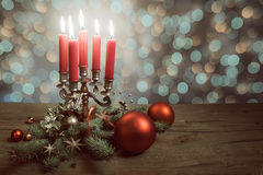 Christmas arrangement on wood with xmas tree, baubles and candle Royalty Free Stock Photos