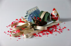 Christmas arrangements and money Royalty Free Stock Images