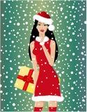 Christmas art. Beautiful santa-woman with present Stock Image