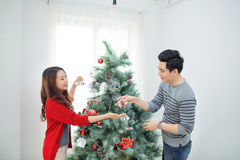 Christmas Asian Couple.Happy Smiling Family at home celebrating. Stock Images