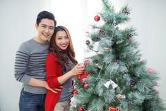 Christmas Asian Couple.Happy Smiling Family at home celebrating. Royalty Free Stock Image