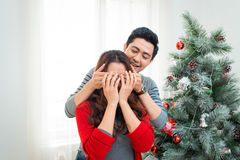 Christmas Asian Couple.Happy Smiling Family at home celebrating. Stock Image