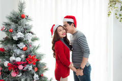Christmas Asian Couple.Happy Smiling Family at home celebrating. Royalty Free Stock Photos