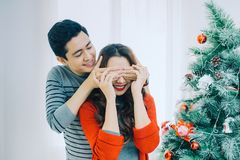 Christmas Asian Couple.Happy Smiling Family at home celebrating. New Year People royalty free stock photo