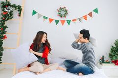 Christmas. Asian Couple at home celebrating New Year. Stock Image