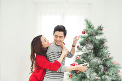 Christmas. Asian couple lovers at home celebrating New Year People Stock Photography