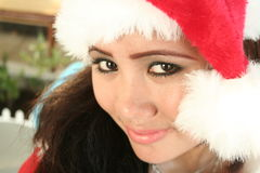 Christmas asian style. Asian girl with santa hat royalty free stock photography