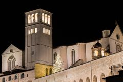 Christmas 2017 in Assisi Umbria, with a view of San Francesco. Papal church at night, with big lighted tree stock images