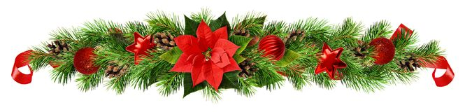 Christmas asymmetric garland with red pionsettia flower, pine twigs and decorations stock photo