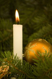 Christmas atmosphere. With a candle Stock Images