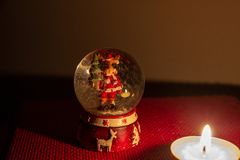 The Christmas atmosphere of a glass ball with a reindeer inside stock photo