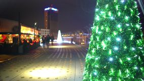 Christmas atmosphere in night city, happy couples enjoying dates, time lapse. Stock footage stock video