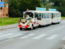 Christmas attractions, children`s train. Train of Santa Claus in Italy. A New Year`s Eve in Italy. stock photo