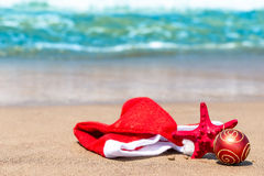 Christmas attributes and starfish. On the beach royalty free stock photos