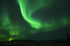 Christmas Aurora 11. Green Dance in the sky on Xmas Eve, performed by Northern Lights Royalty Free Stock Photo