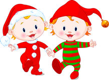 Christmas Babies. Two cute babies with Christmas costumes Stock Photos