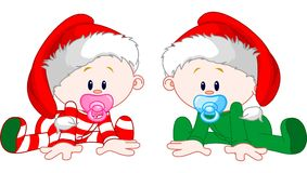 Christmas Babies. Two cute babies with Christmas costumes Stock Images