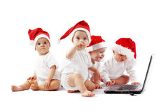 Christmas babies with laptop Stock Photos