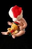 Christmas baby. Baby with christmas hat with bear Stock Image