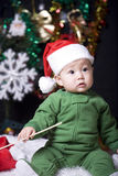 Christmas baby. Cute christmas baby in santa hat Stock Photos