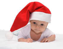 Christmas baby. Baby in the christmas cap Stock Image