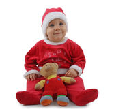 Christmas baby. Adorable sitting christmas baby isolated on white Stock Photos
