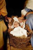 Christmas baby. 20 days old baby sleeping in a christmas nativity crib Royalty Free Stock Photography