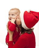 Christmas baby. Isolated happy baby in her mother lap Stock Photos