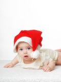 Christmas baby. Newborn baby with christmas cap Royalty Free Stock Photos