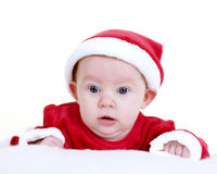Christmas Baby. Baby girl in a christmas outfit isolated on white royalty free stock image