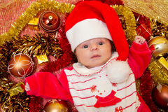 Christmas baby. Portrait of a baby in a large Christmas hat Royalty Free Stock Images