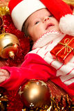 Christmas baby. Portrait of a baby in a large Christmas hat Stock Image