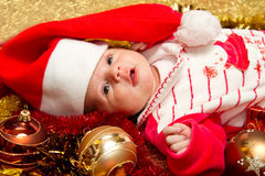 Christmas baby. Portrait of a baby in a large Christmas hat Stock Photos