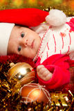 Christmas baby. Portrait of a baby in a large Christmas hat royalty free stock photo