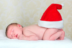 Christmas baby. Funny Christmas baby with santa hat on butt Royalty Free Stock Photos