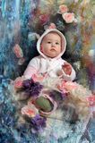 Christmas baby. Girl in pink next to the Christmas tree Royalty Free Stock Photos
